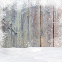 Christmas pine wooden background with snowfall and snowdrift. View with copy space