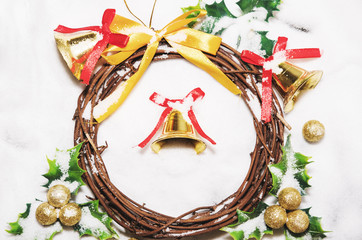 Christmas background, Wreath woven from the branch of the vine with golden bells and green leaf with golden ball