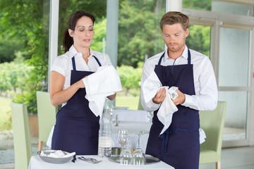 restaurant staff cleaning wine glasses