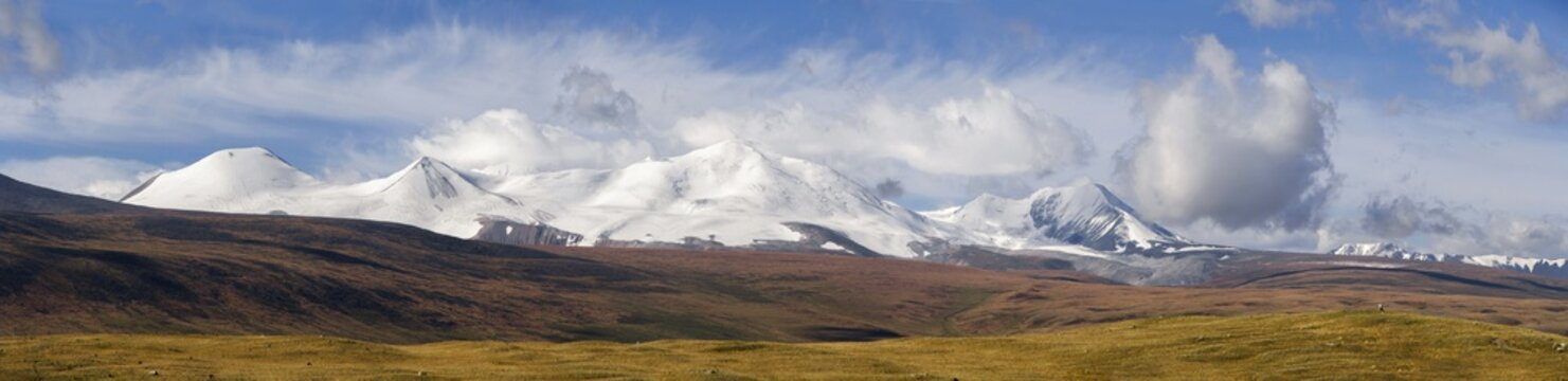 Altai, Ukok plateau. Beautiful sunset with mountains in the background. Snowy peaks autumn. Journey through Russia, Altay