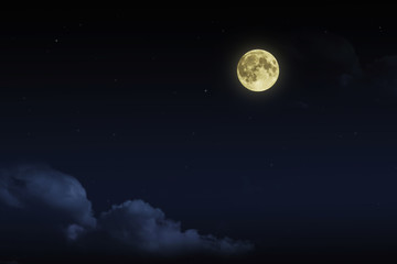 Beautiful magic blue night sky with clouds and fullmoon  stars