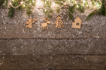 christmas decorations with snow on the wooden background