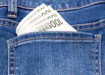 euro money in blue jeans pocket background