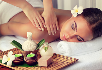 Türaufkleber Spa Body care. Spa body massage treatment. Woman having massage in the spa salon