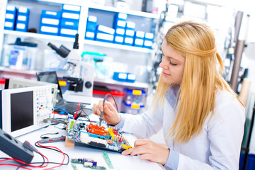 Engineer working with circuits. A woman engineer