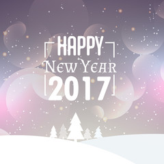beautiful snowy background with 2017 new year wishes