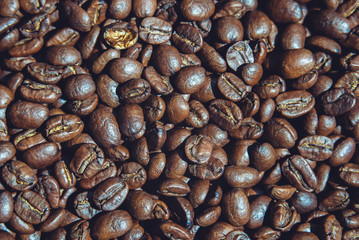 roasted coffee beans on the surface closeup top view, background