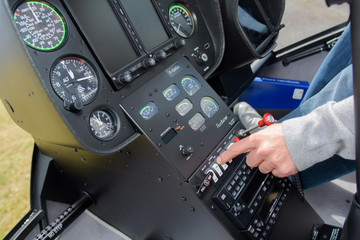 cockpit view of helicopter and pilot