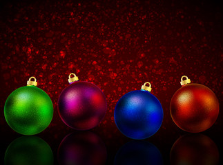 Multi-colored Christmas balls on a red background bokeh