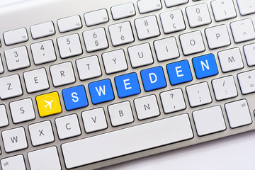 SWEDEN writing on white keyboard with a aircraft sketch