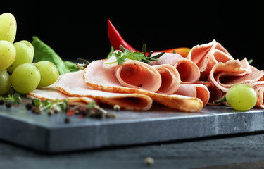 cold meat plate. Sliced ham with lettuce, shallow depth, selective focus