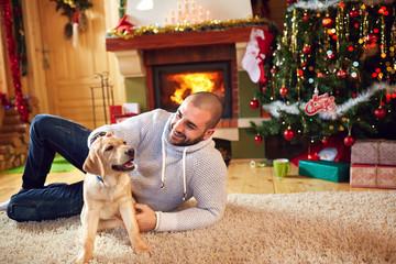 Man with dog enjoying for Christmas holiday