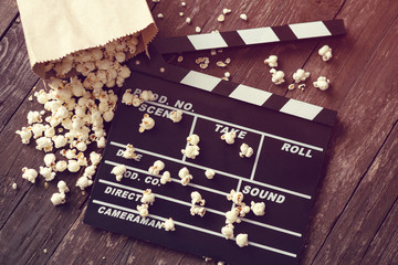 movie clapper board with popcorn.
