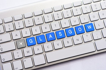 GLASGOW writing on white keyboard with a aircraft sketch