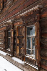 Traditional rural wooden house at winter