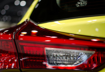 Details of taillights of a yellow sport car