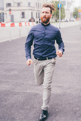 Young handsome caucasian man running outdoor in the city - hurry, sportive, late concep