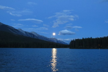 Moonrise that create a light bridge on the lake. Banff, Canada.