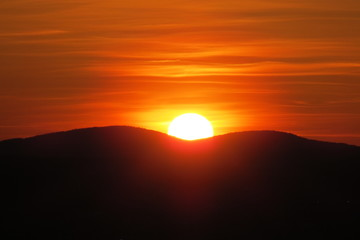 Orange sunset behind the mountains. Quebec, Canada.