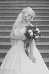 Black and white photo of the bride with a bouquet  flowers