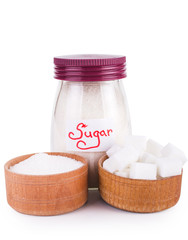 glass jar with sugar. Isolated on white.
