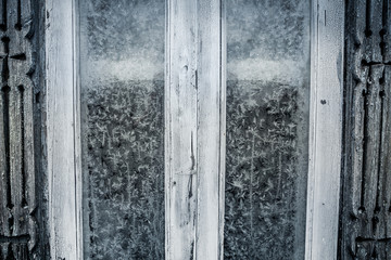 Rustic frosted window with vintage wood frame as Christmas background