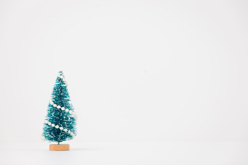 little Christmas tree isolated on white background
