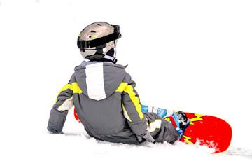 Small boy snowboarding