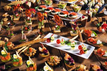 Snacks set. Brushettas, canapes, salads, desserts, tartlets, oys