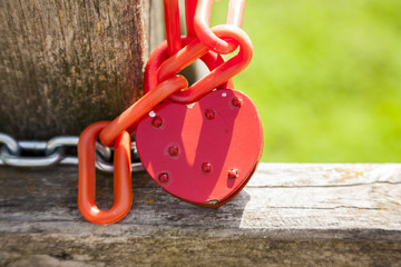 Padlock in the shape of hearts, red metal heart.