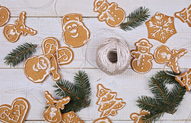 Christmas tree decoration made from gingerbread cookies on wooden table. New year background