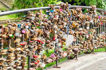 Love padlock wall on the bridge in the park.