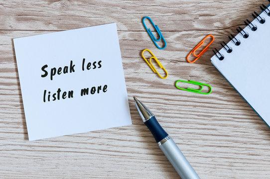 Speak Less Listen More notice on business background