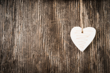 Christmas decoration in heart shape over rustic wood