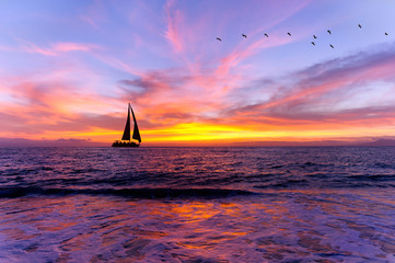 Wall Mural -  Ocean Sunset Sailboat Silhouette