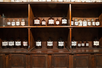 Vintage bottles with ingredients in the old pharmacy