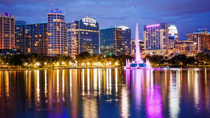 Orlando, Florida City Skyline on Lake Eola at Night (logos blurred for commercial use)