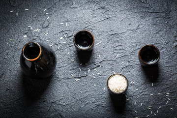 Strong sake in black ceramics on black rock