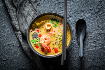 Hot Tom Yum soup with shrimps and coconut milk