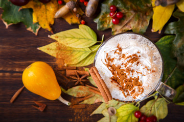Pumpkin Smoothies,Spicy Drink is a cinnamon Dolce Latte,whipped cream .Autumn still life.selective focus.