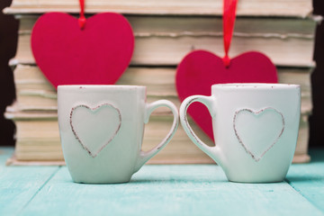Coffee with heart shapes over books background