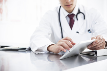 Doctor is watching electronic medical record