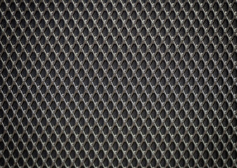 Plastic grille. Grid of audio amplifier background.