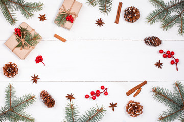 Christmas background with Christmas gift, fir branches, pine cones, snowflakes, red decorations. Xmas and Happy New Year composition. Place for text. Flat lay, top view