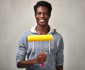 Black man with painting roller