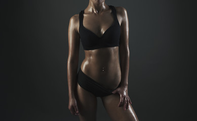 Close up image of  female in sports clothing relaxing after work