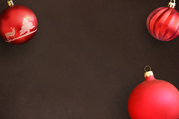 Christmas red and wavy dull balls on dark wooden table