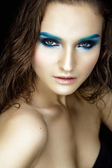 Beautiful woman portrait with blue eye shadows and wet hair.