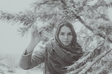black and white, beautiful girl in a headscarf in the woods in winter.