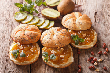 Sweet sandwiches with butter, kiwi jam and peanut close-up. horizontal